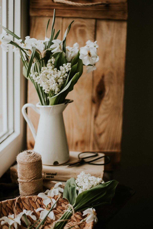 white flowers in white ceramic vase