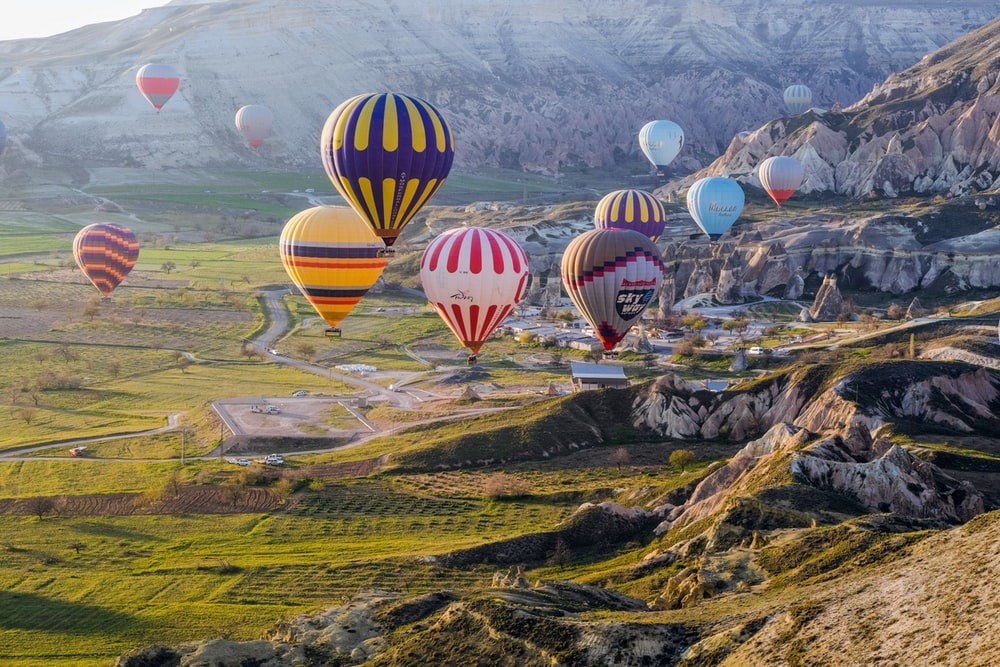 hot air balloons on green grass field during daytime