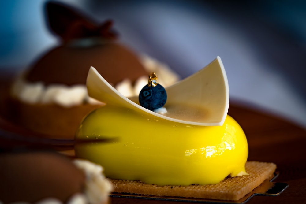 yellow and brown cake on brown wooden table