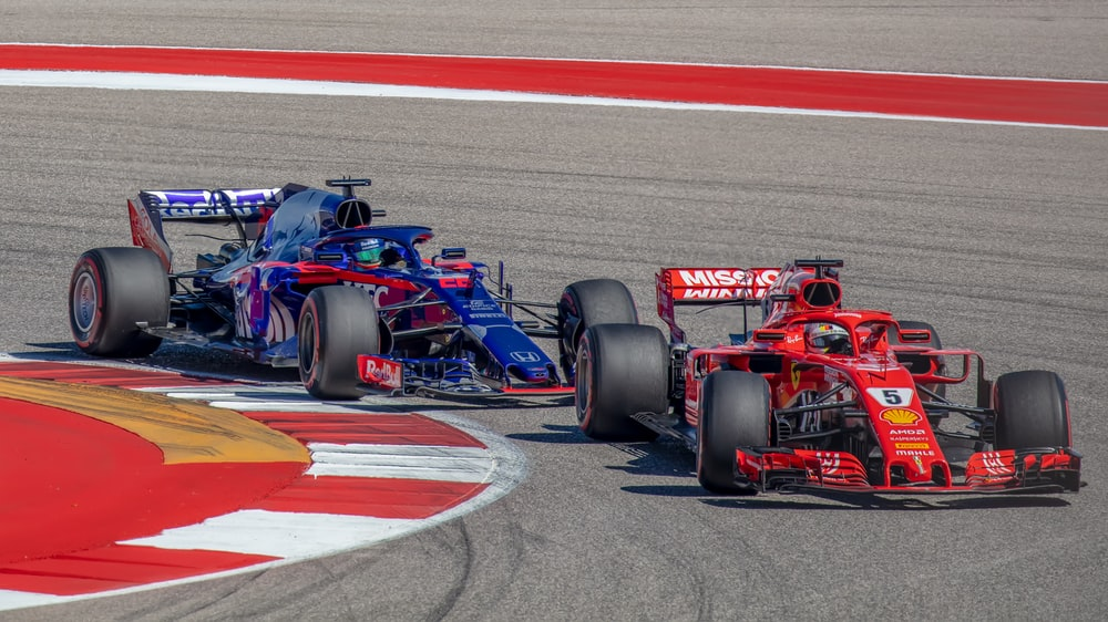 blue and red formula 1 on race track
