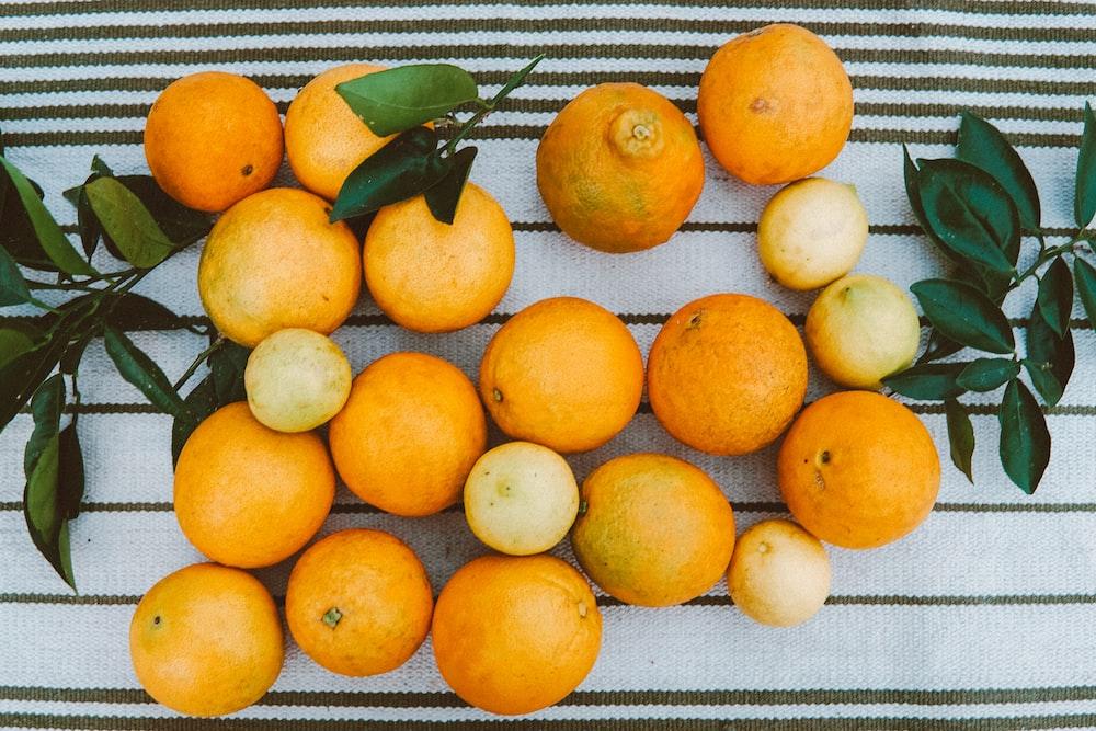 orange fruits on white tray