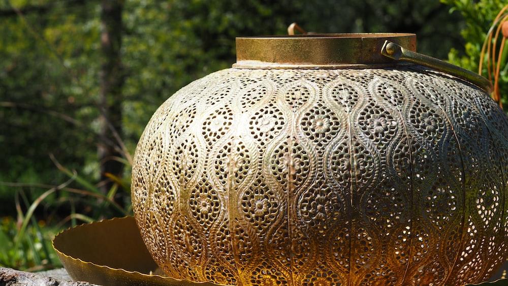 white and gold floral ceramic vase