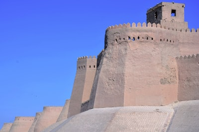 brown concrete castle under blue sky during daytime uzbekistan zoom background