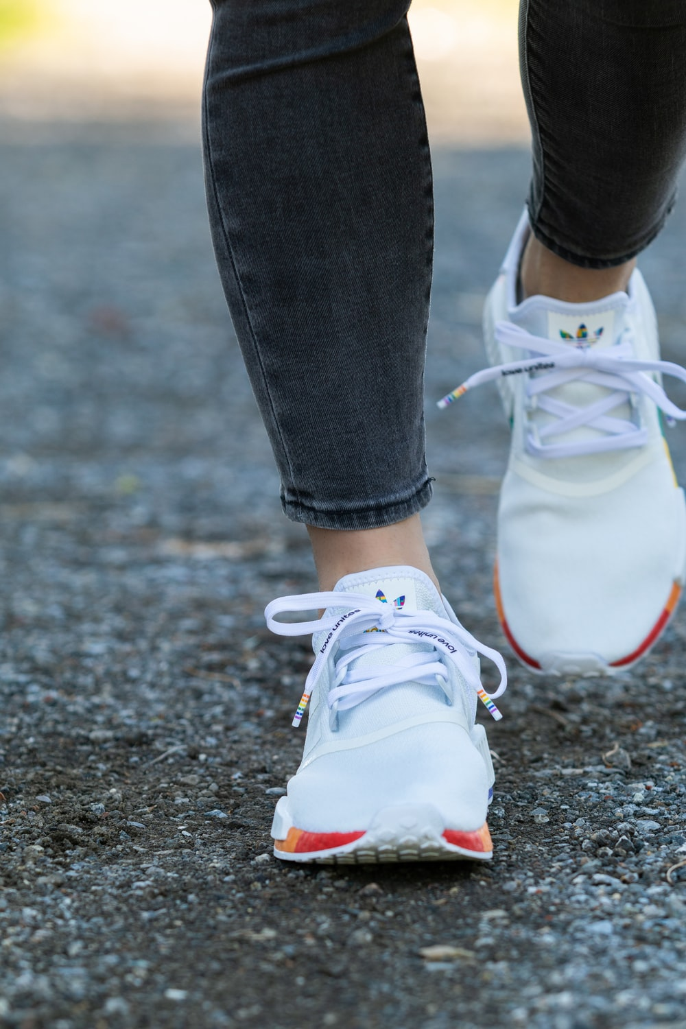 person in white nike sneakers