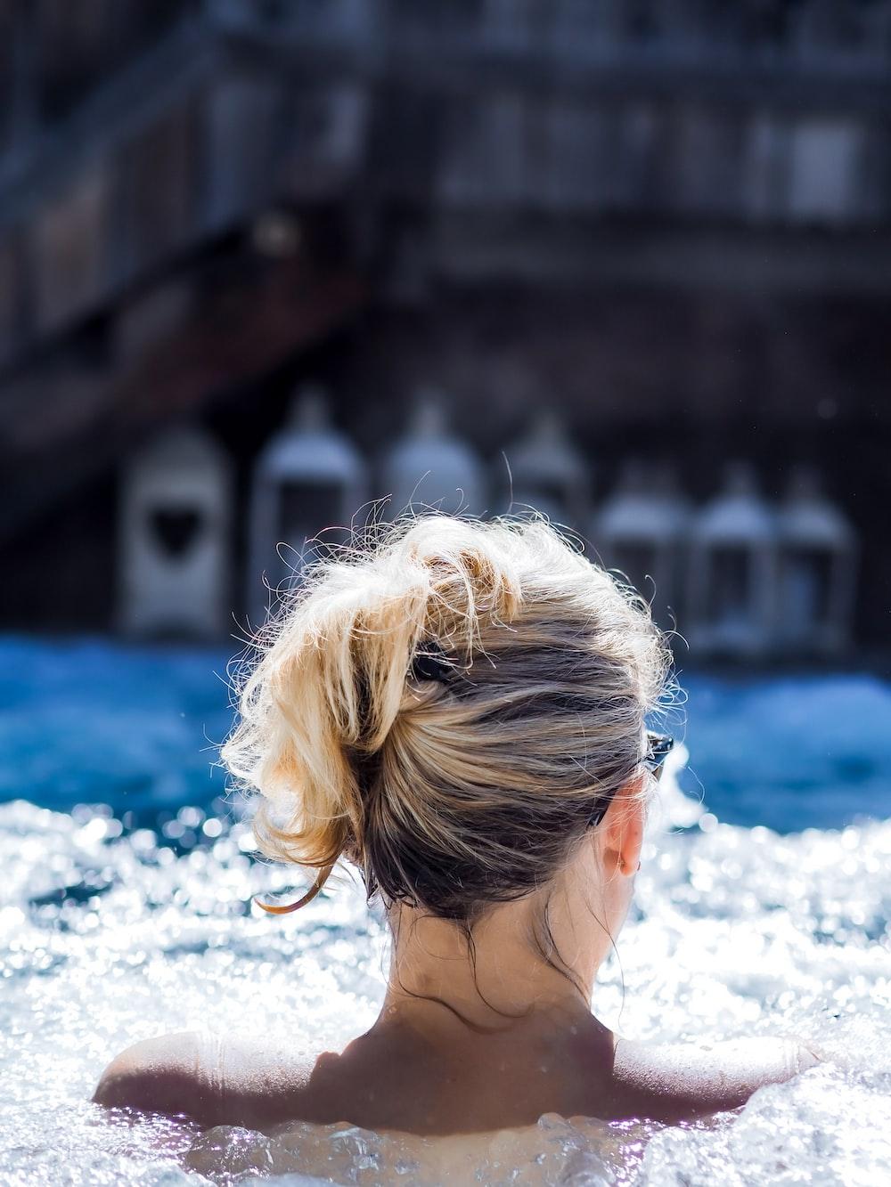 woman in blue and white bikini top on water