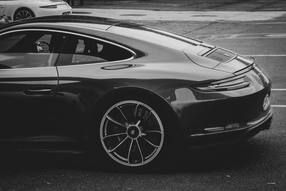grayscale photo of sports car