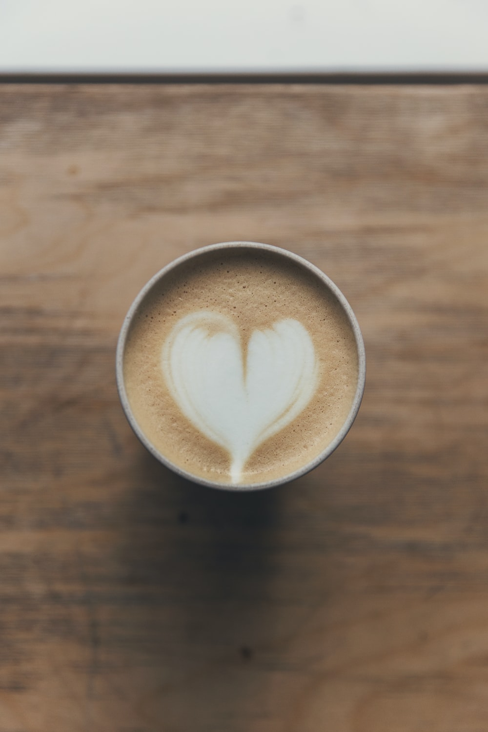brown and white heart shaped coffee art