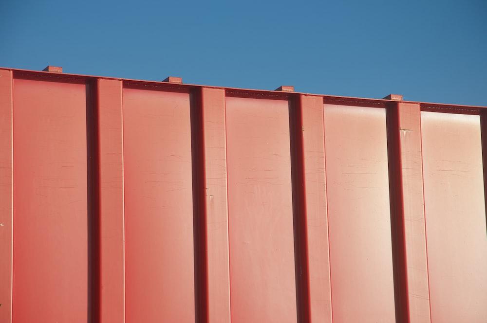 red steel gate under blue sky during daytime