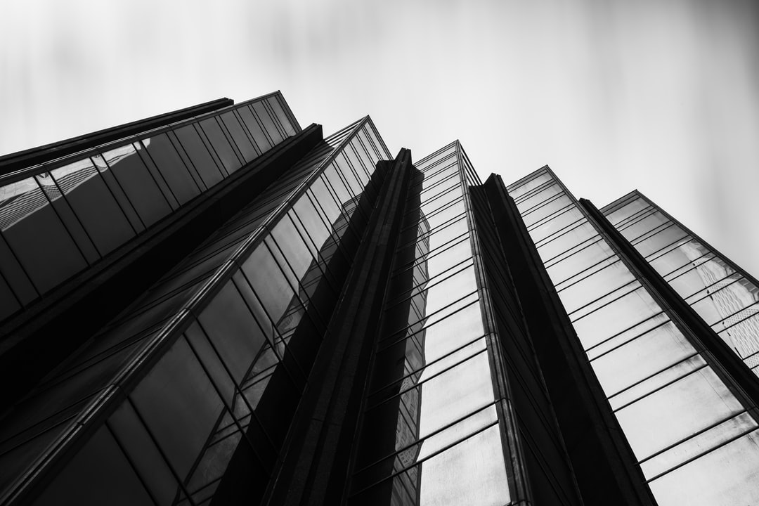 Grayscale Photo of High Rise Building - unsplash