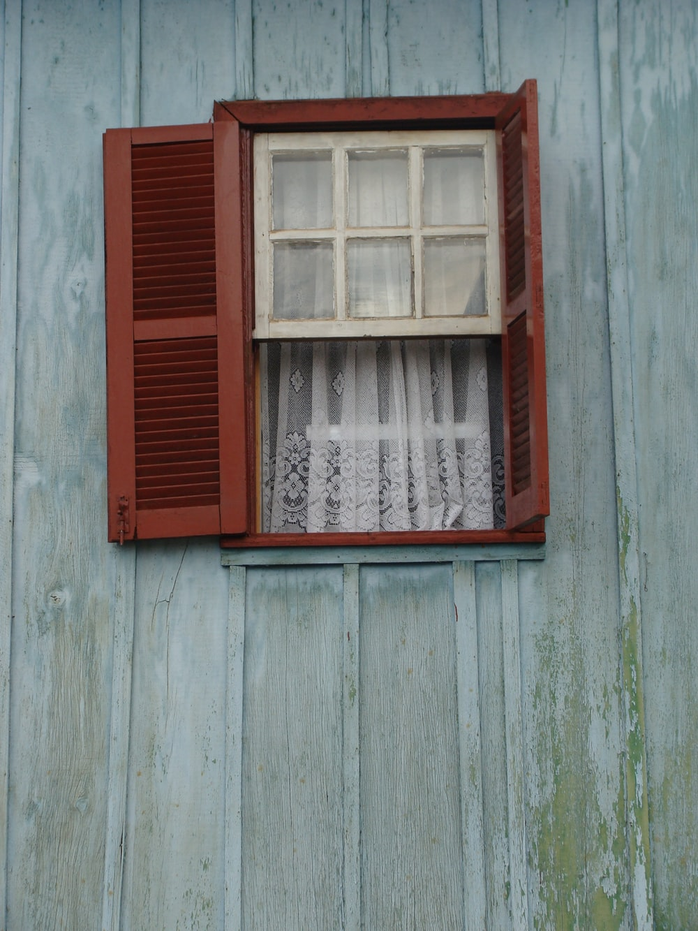 red wooden framed glass window