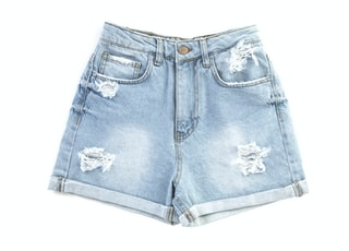 blue denim shorts on white surface
