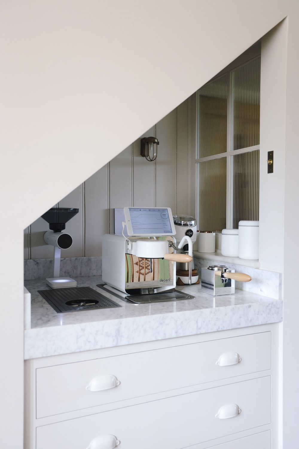 white and black microwave oven on white wooden kitchen cabinet