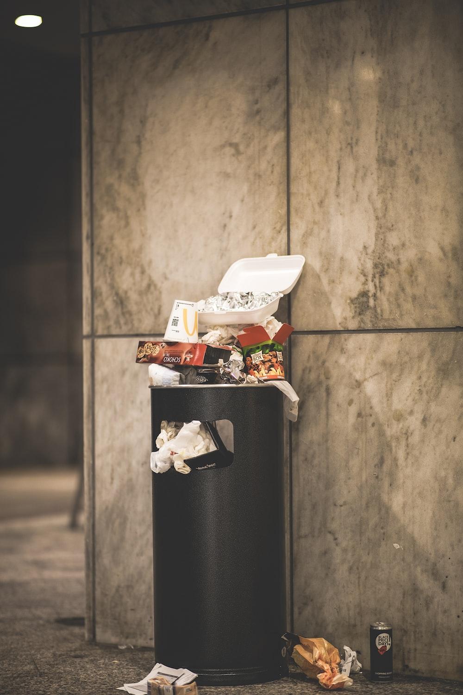 black and white plastic trash bin