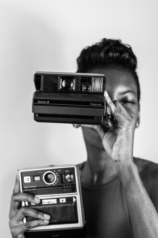 grayscale photo of polaroid camera