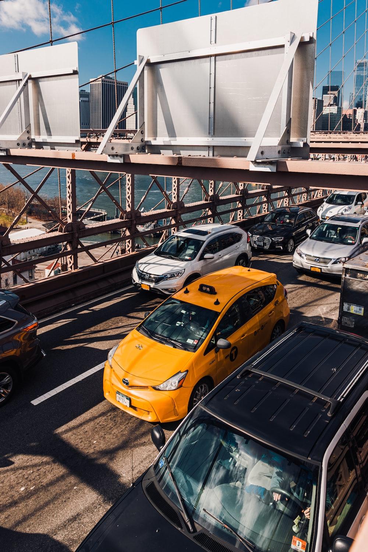 yellow car on gray concrete bridge during daytime