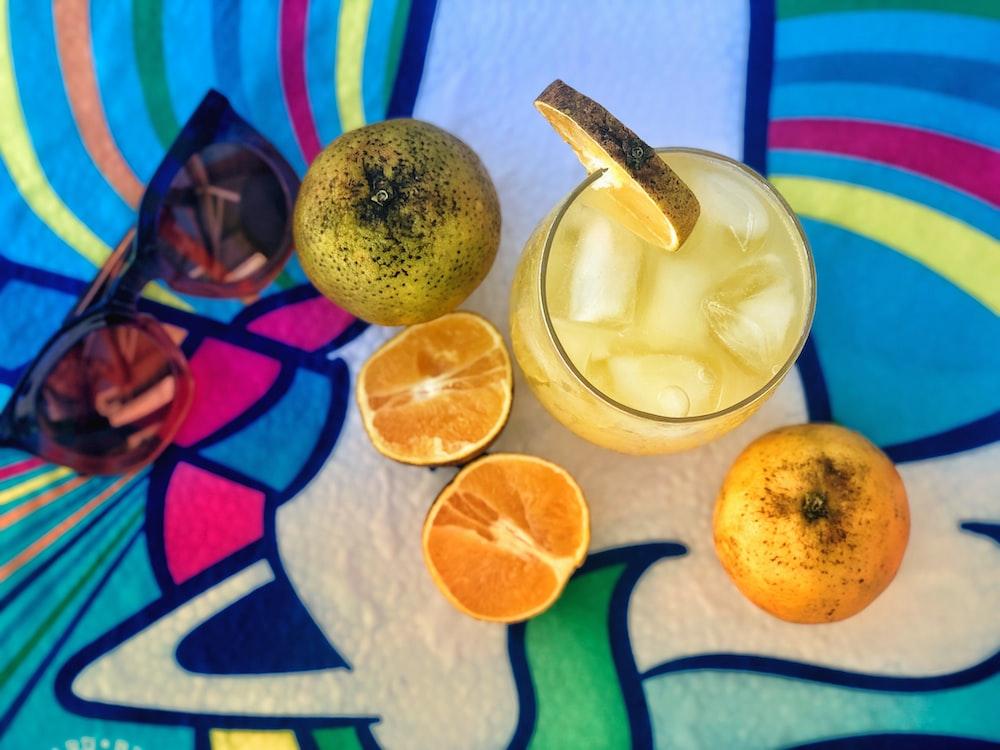 sliced lemon beside clear drinking glass