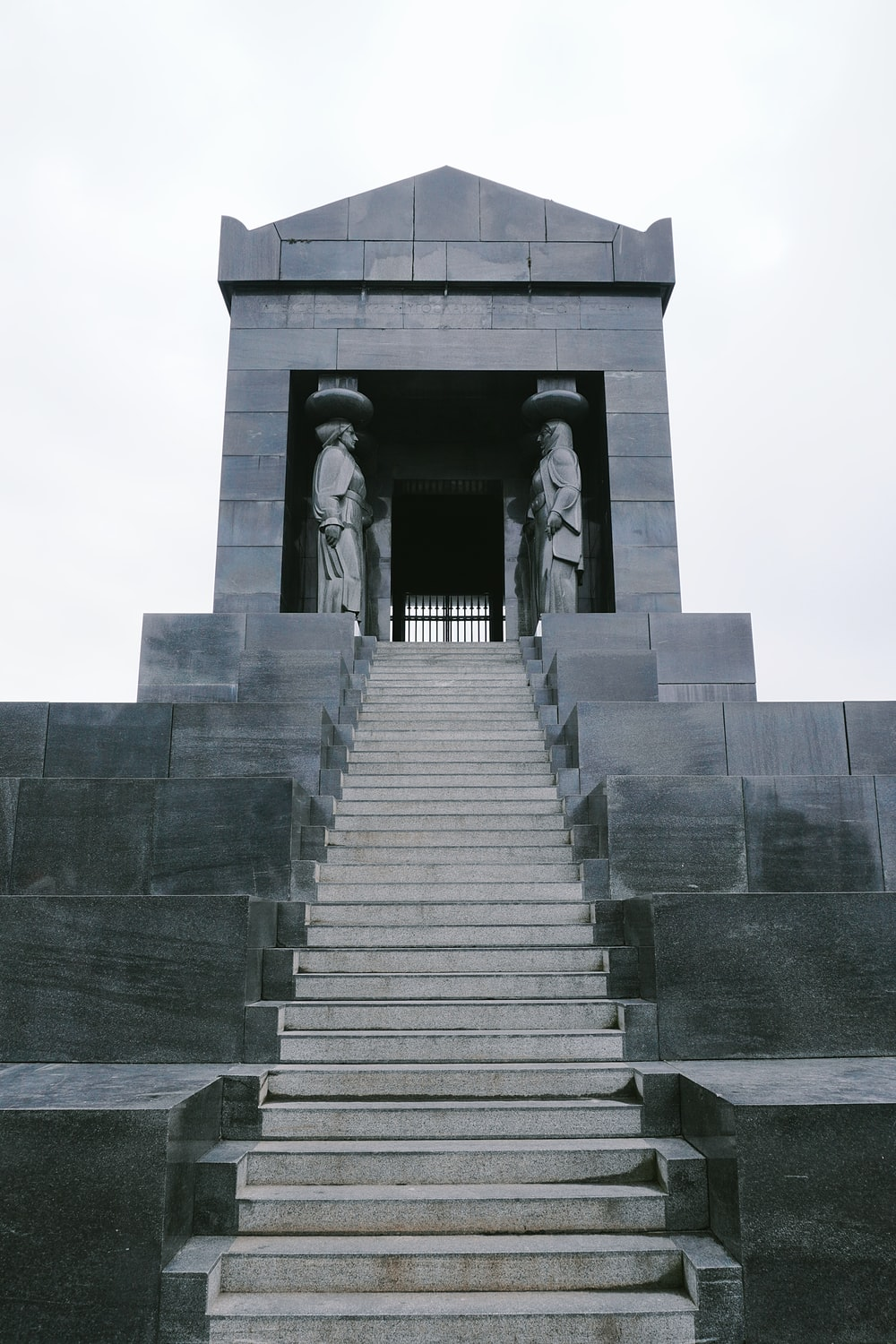 gray concrete stairs with gray concrete railings