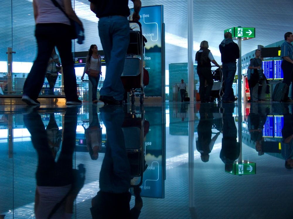 people standing in front of glass wall