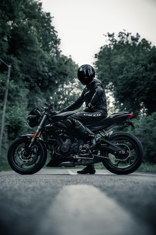 man in black motorcycle helmet riding motorcycle during daytime