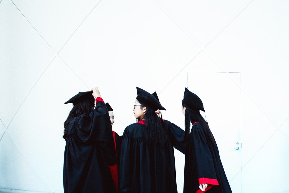 people in academic dress standing