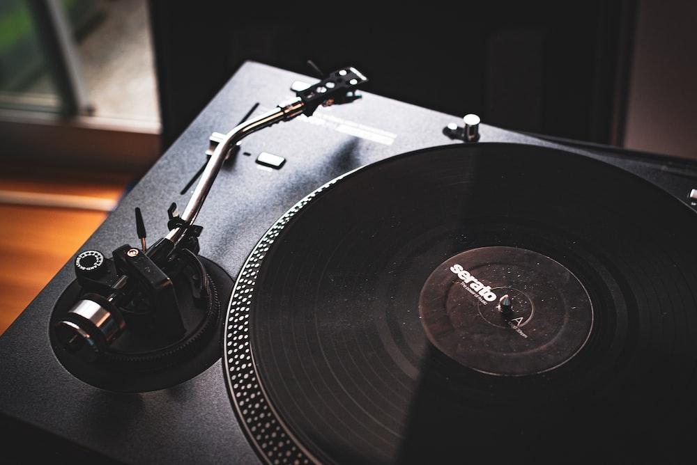 black vinyl record player on black vinyl record player