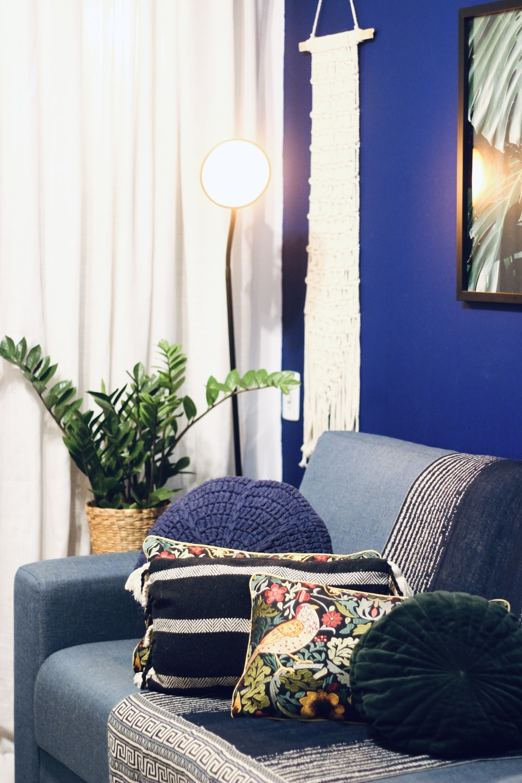 gray sofa with throw pillows