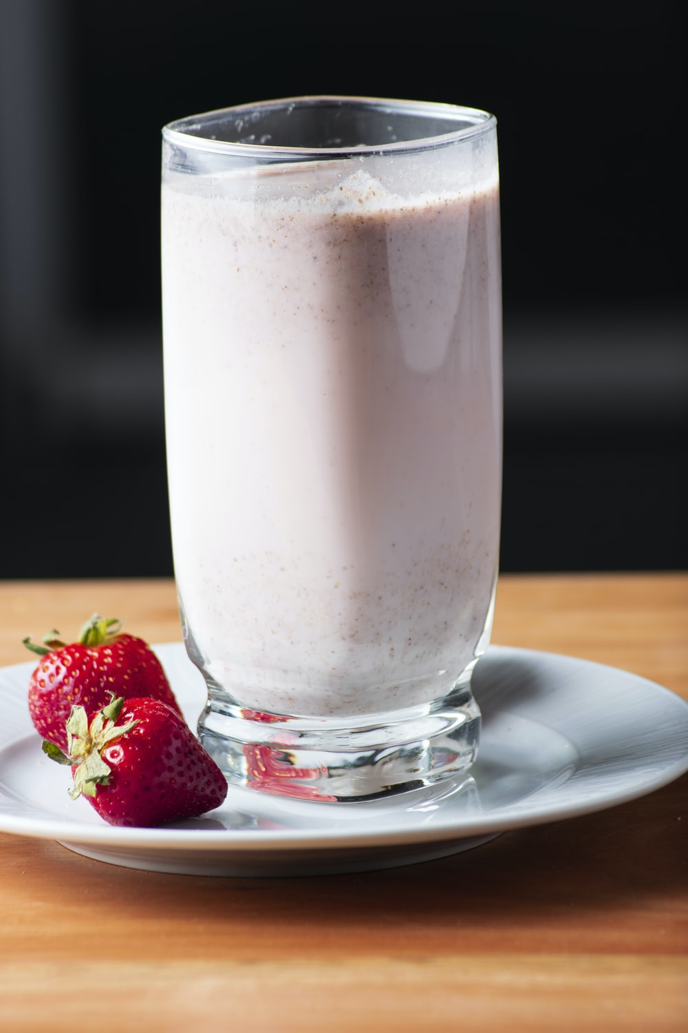 clear drinking glass with strawberry juice