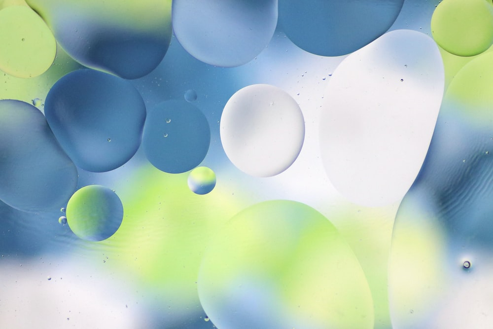 blue and white balloons in close up photography