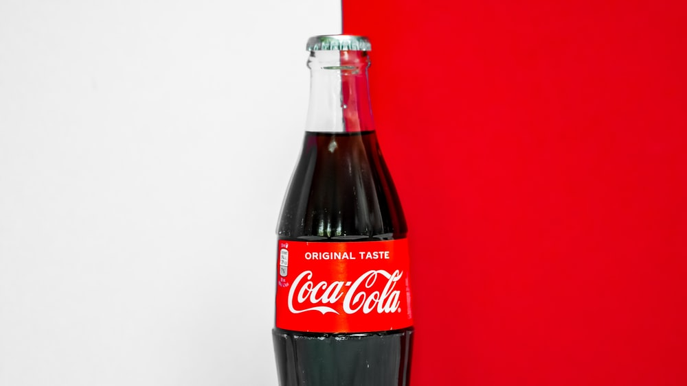 coca cola bottle on white table