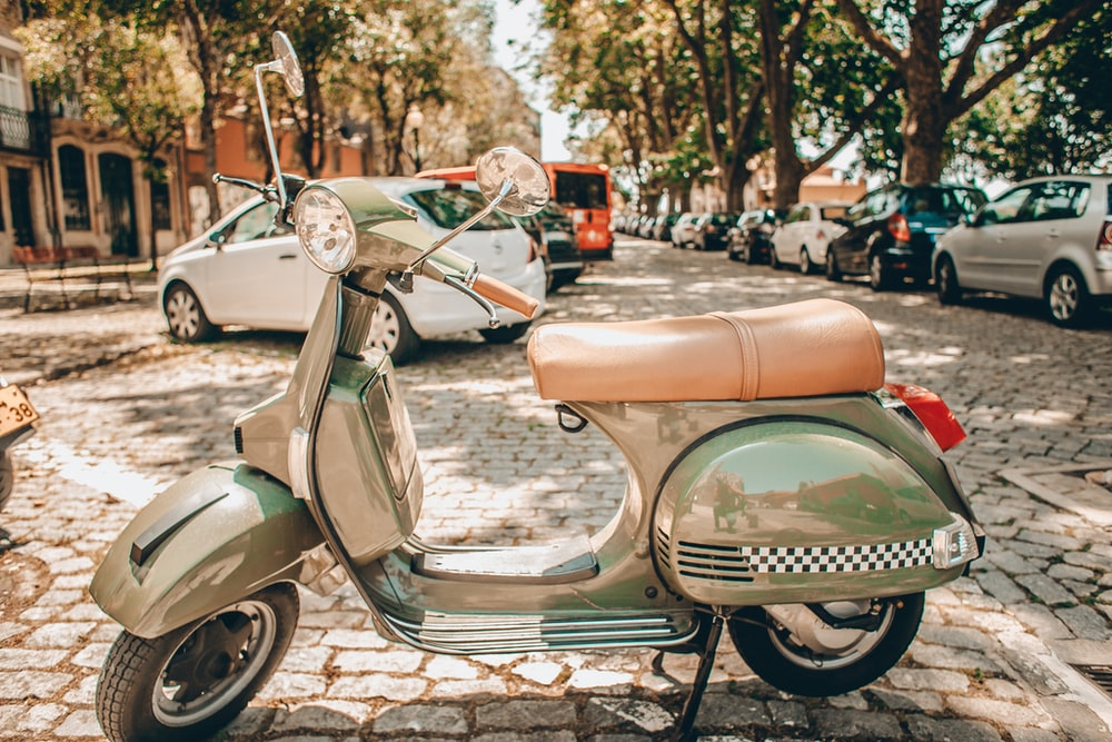 green and brown motor scooter