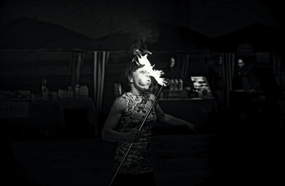 woman in white tank top smoking
