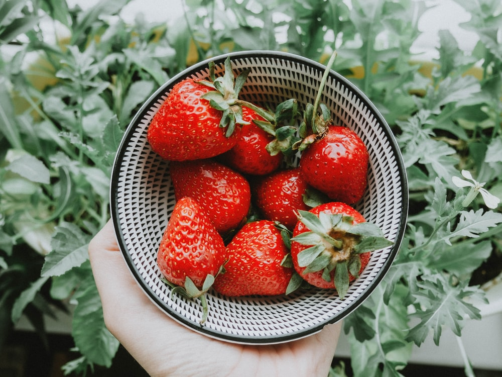 strawberries on stainless steel bowl