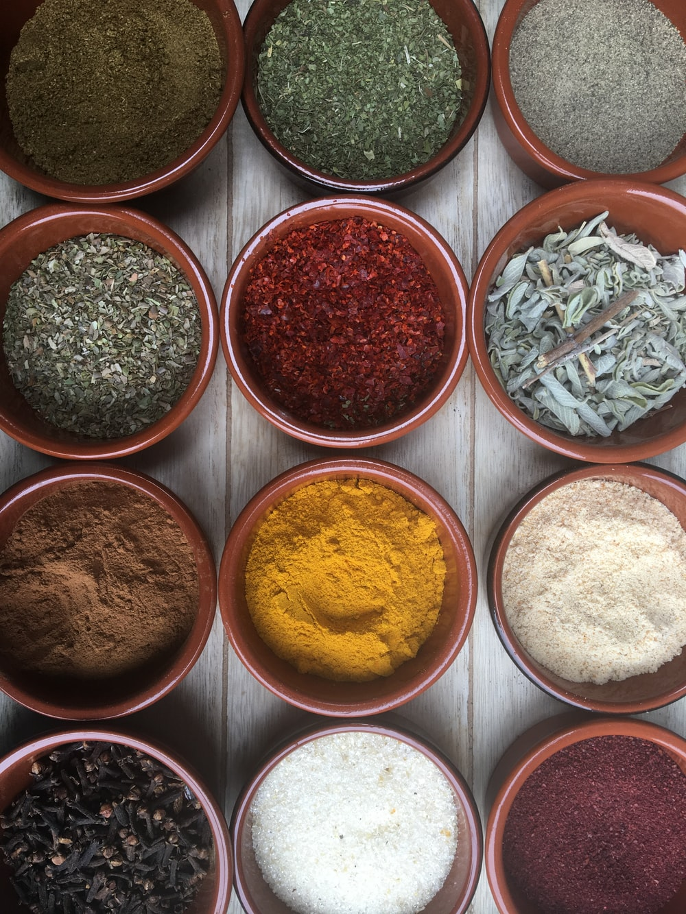 assorted spices in clear glass containers