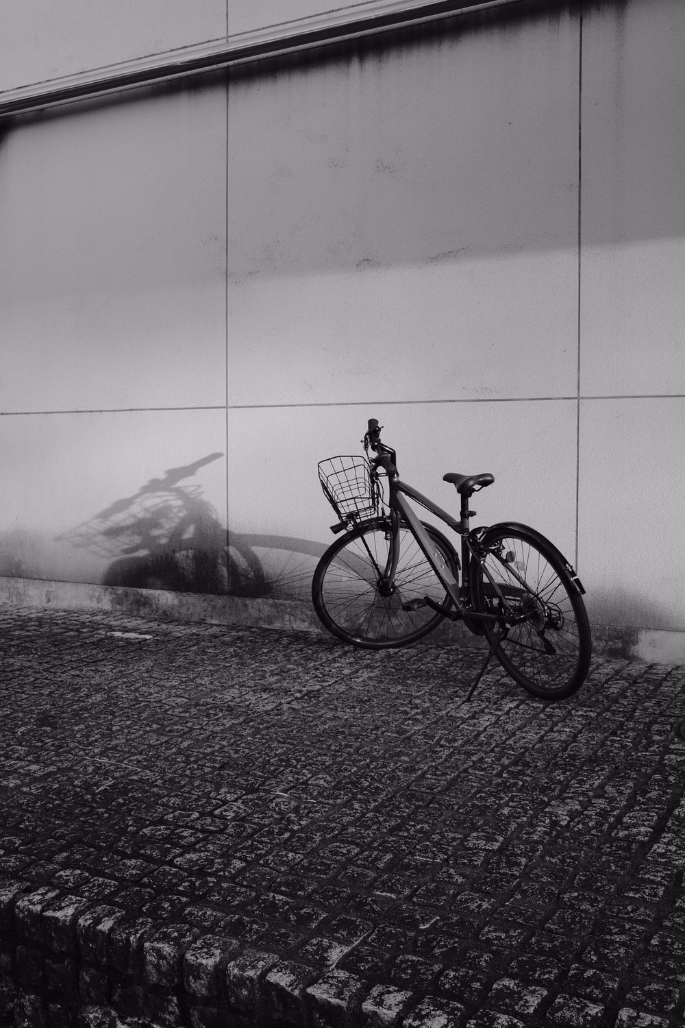 grayscale photo of a bicycle on a beach