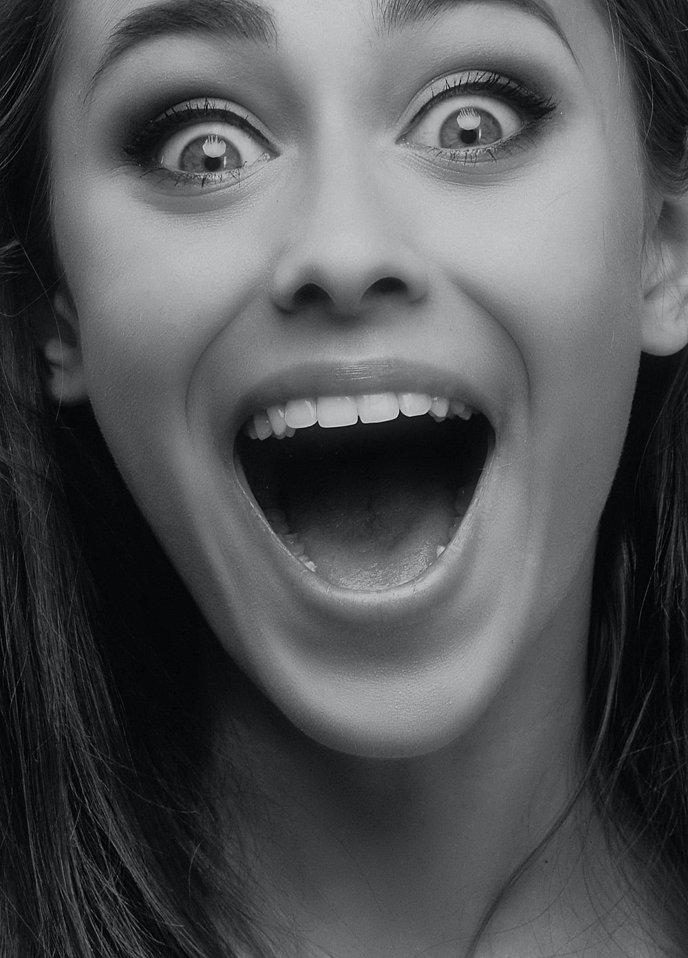 grayscale photo of woman open mouth
