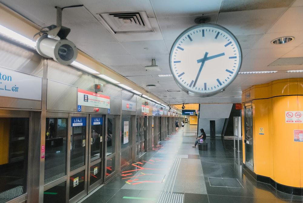 white and black analog wall clock at 11 00