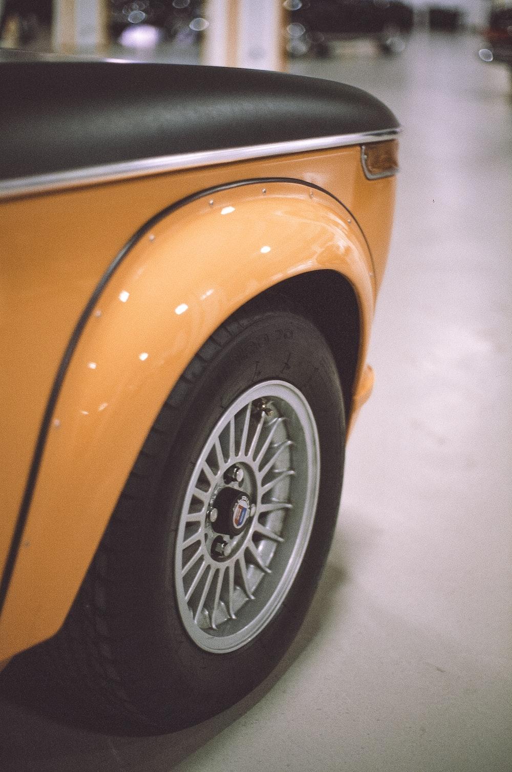 orange car with white snow