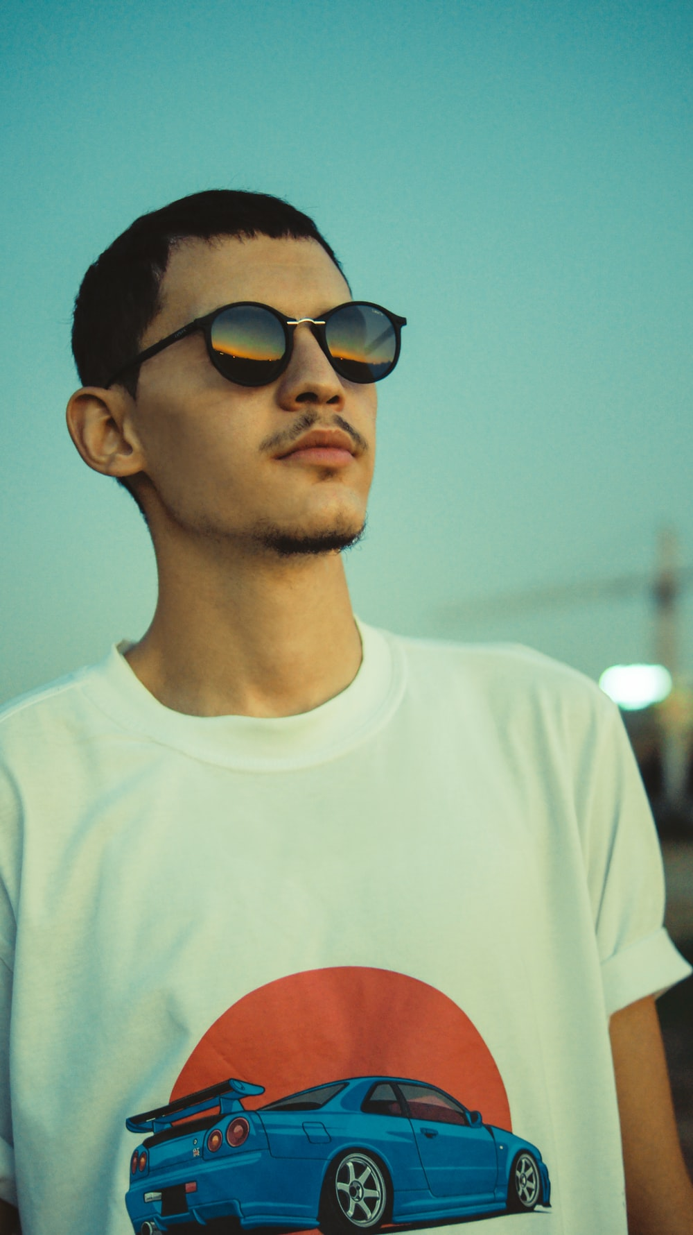 man in white crew neck shirt wearing black sunglasses
