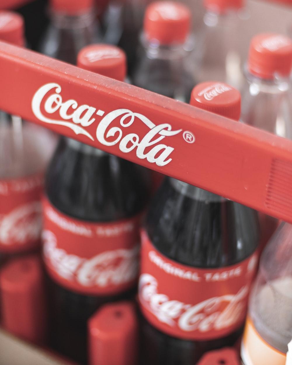 coca cola plastic bottle on red plastic crate