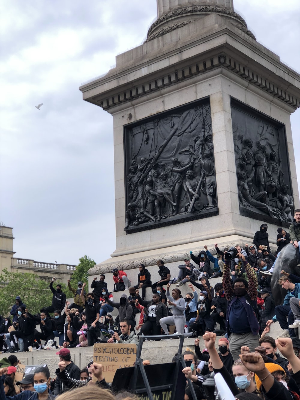 people gathering in front of gray concrete statue during daytime
