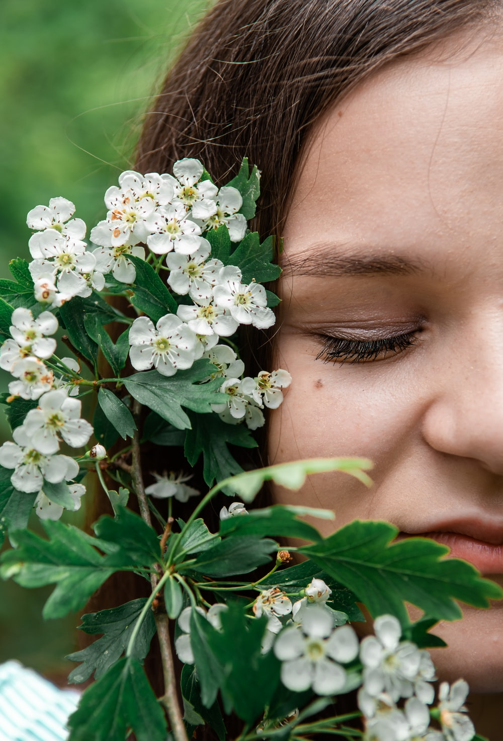 woman in green eye shadow in white flowers