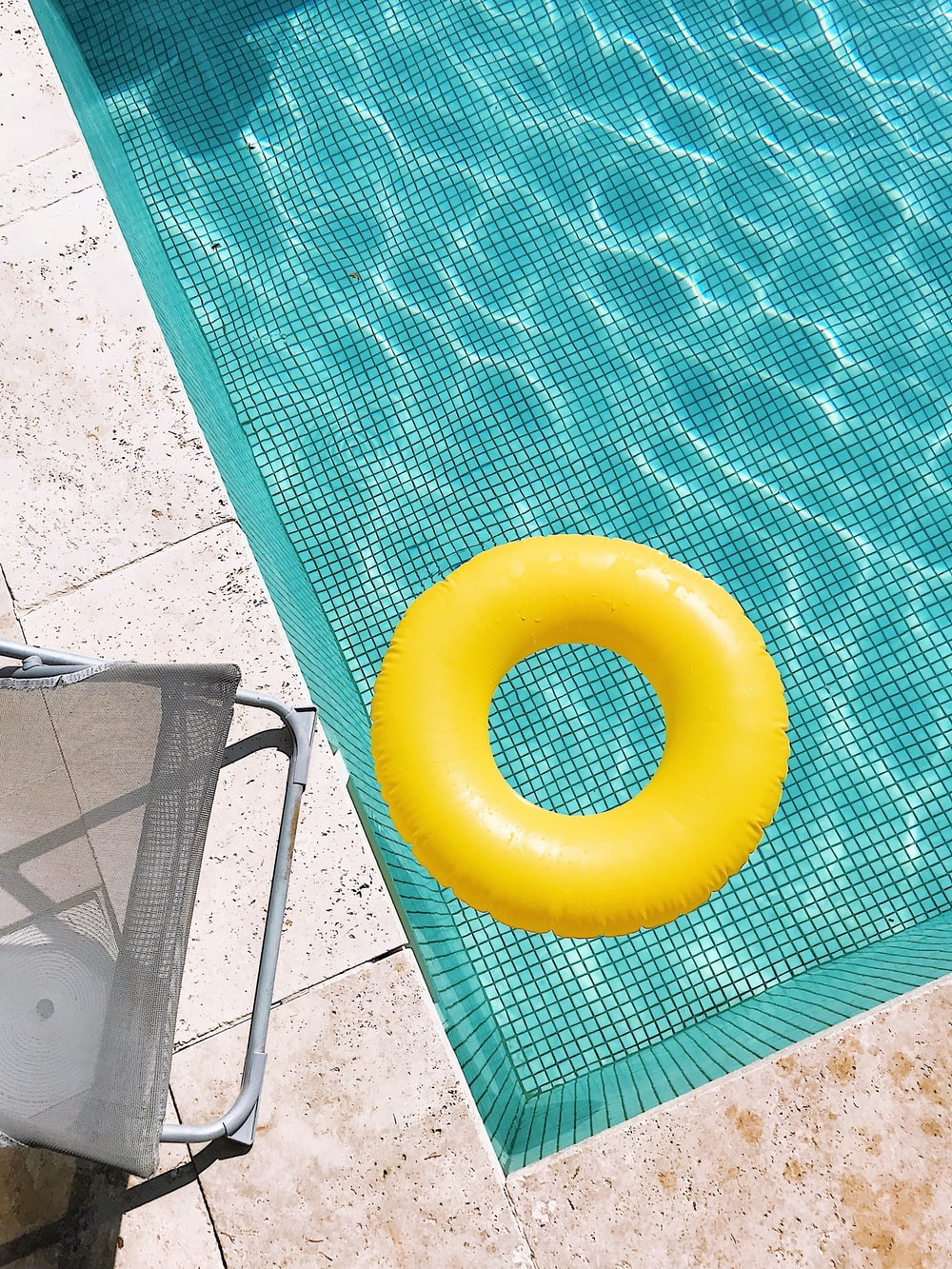 yellow plastic round toy on green table