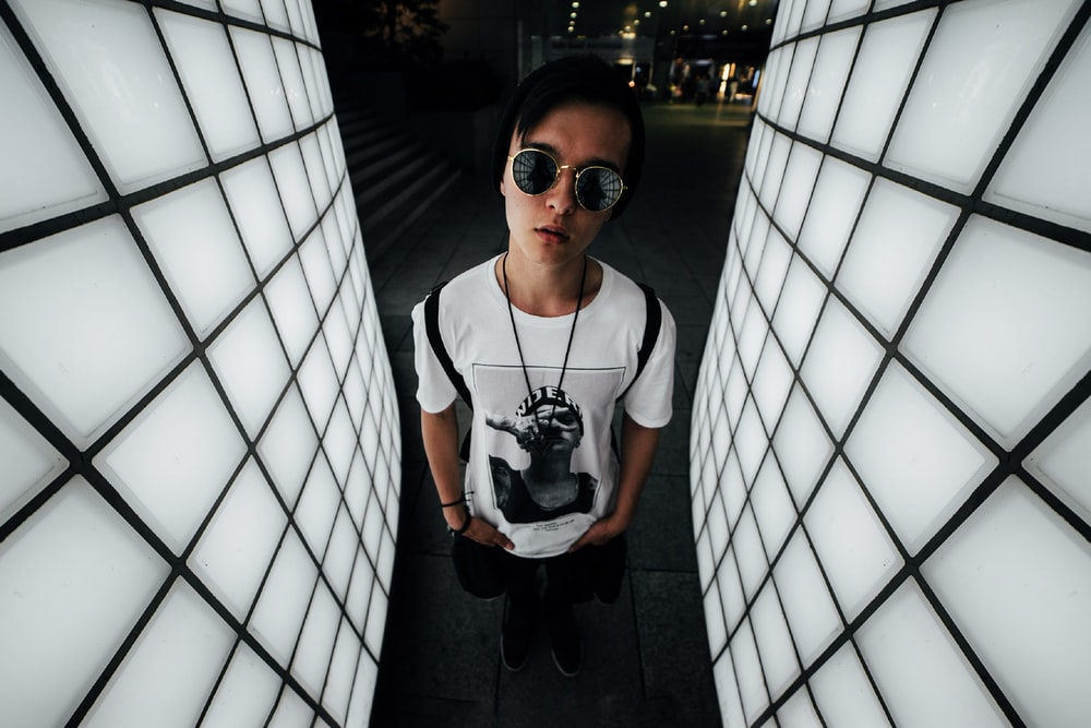 man in white crew neck t-shirt wearing black sunglasses
