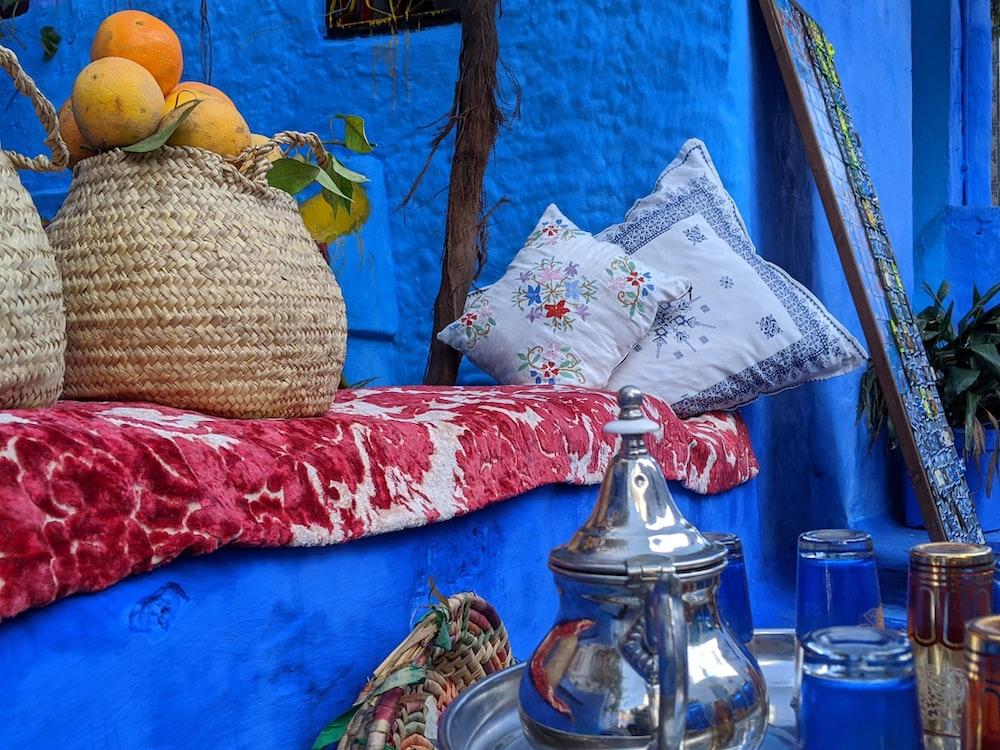 clear glass jar on blue textile