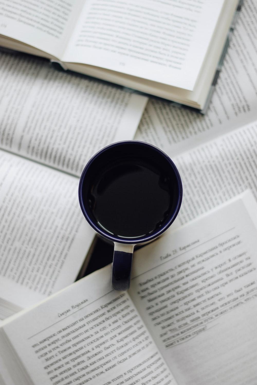 black ceramic mug on white paper