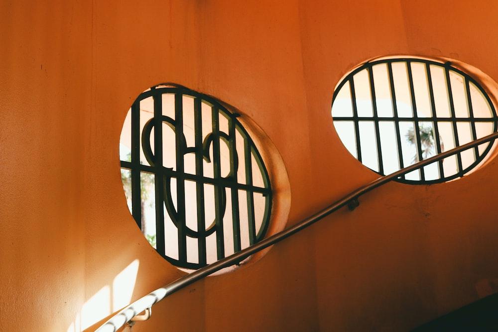 black metal round frame on orange wall