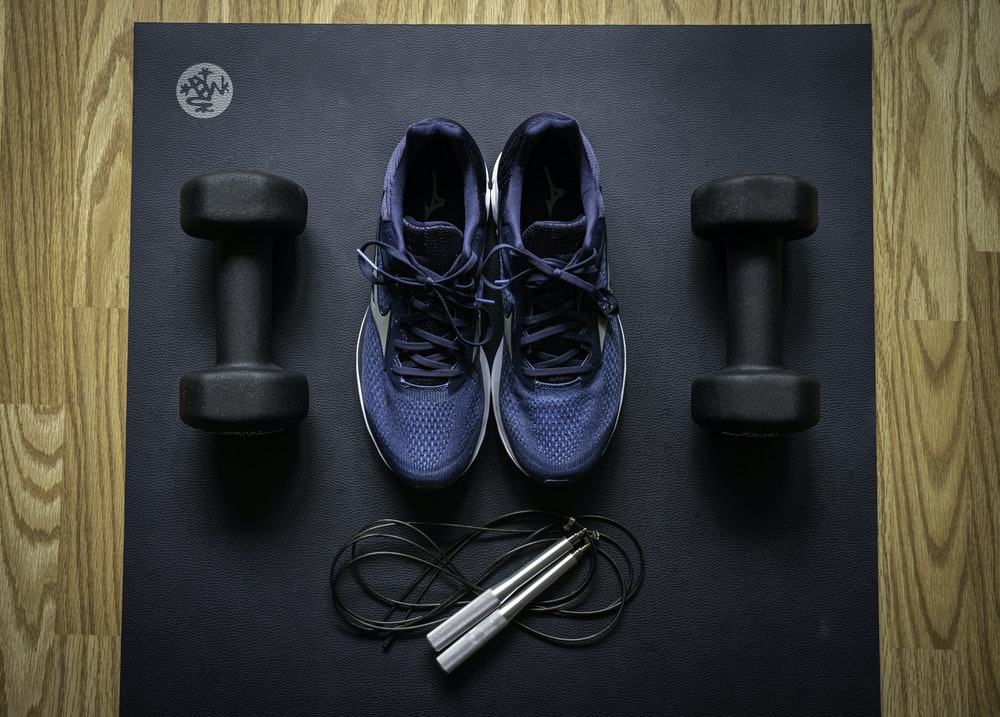 blue and black nike athletic shoes