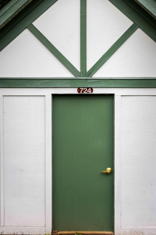 green wooden door with brass door knob