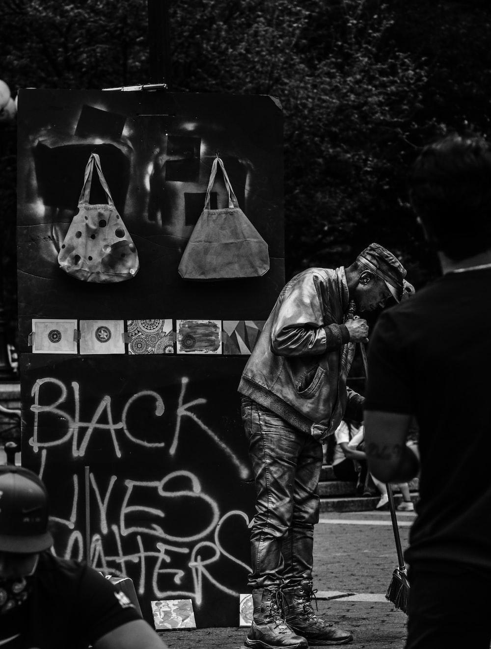man in black jacket and black pants standing near man in black jacket