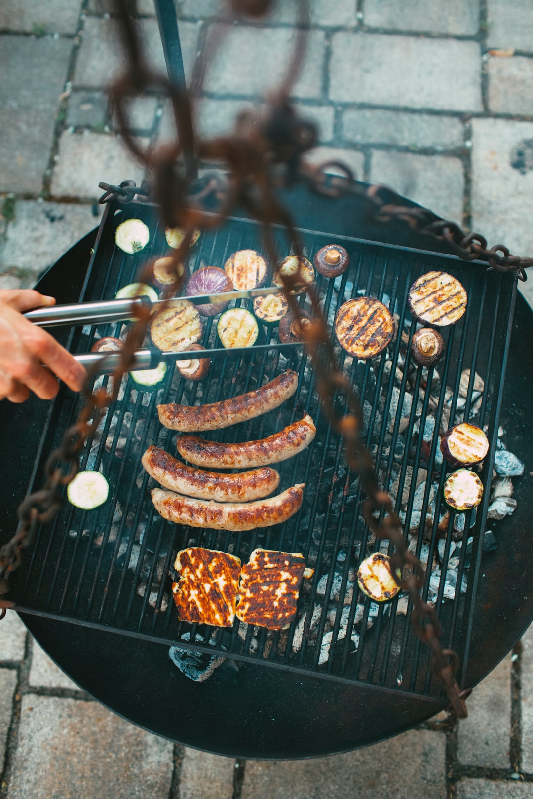 """BBQ with some original Franconian specialty """"Bratwurst"""" (grilled frying sausage) grilled cheese, onion, mushroom and zucchini"""